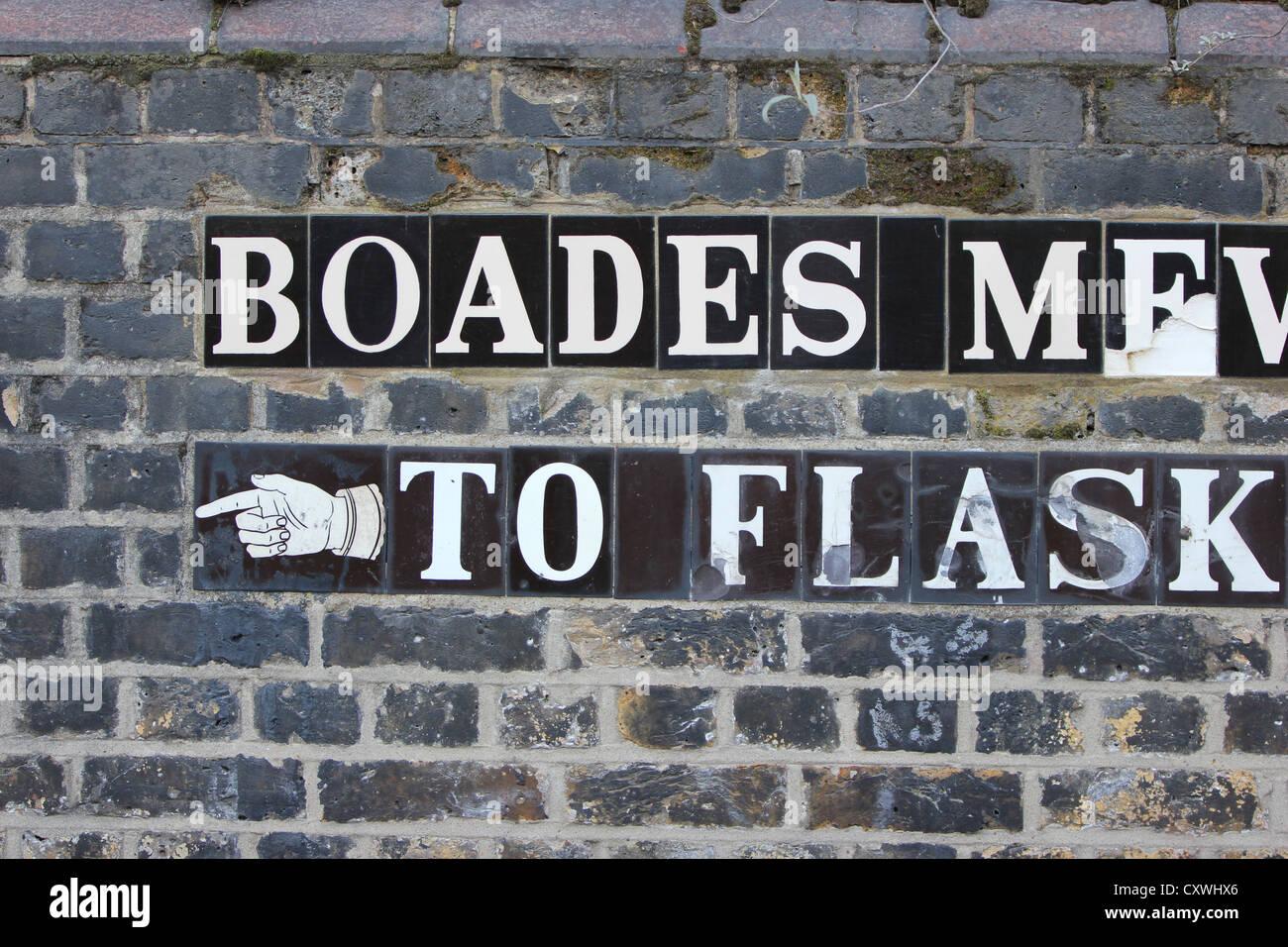 decorative tiles, writing, wall, street signs, London, U.K., city, europe, photoarkive - Stock Image