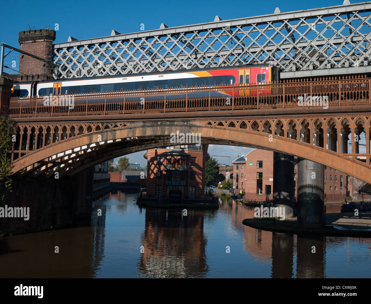 Train passing over bridge, Castlefield, Manchester - Stock Image