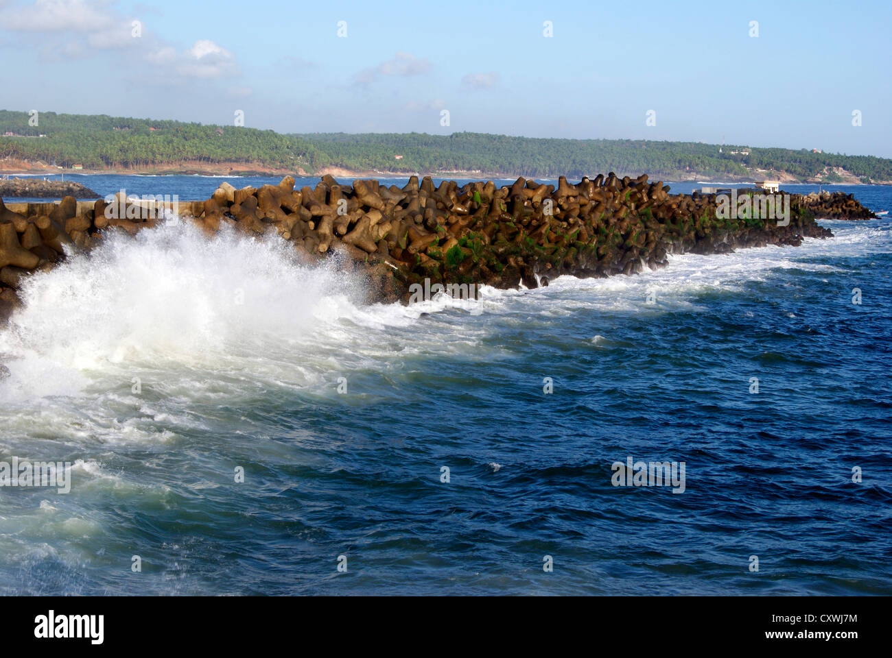 Sea Waves Lashing strongly on the Protective sea walls of Vizhinjam Harbor near Kovalam Beach at Kerala,India - Stock Image