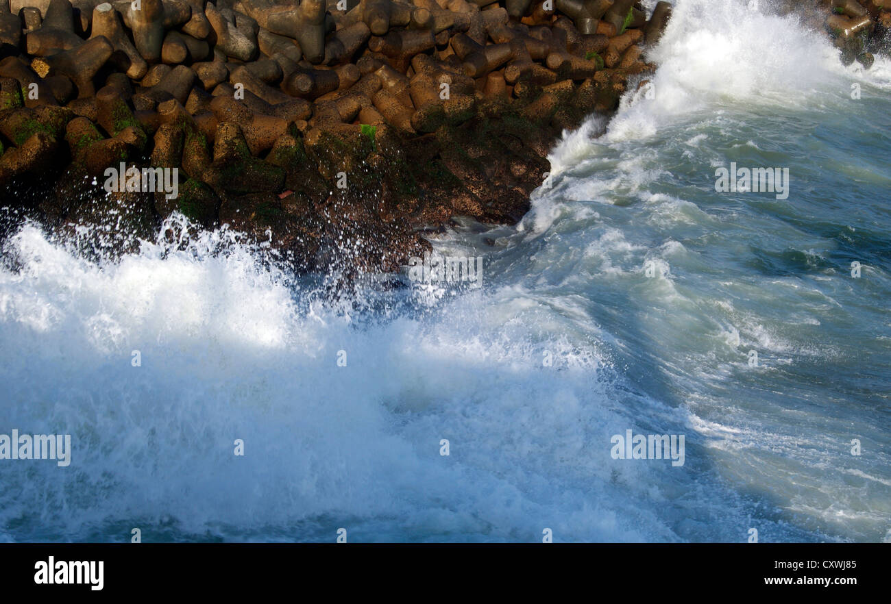 Sea Wall Protecting Vizhinjam Harbor and Beach from the furious Sea Waves of Arabian Sea - Stock Image