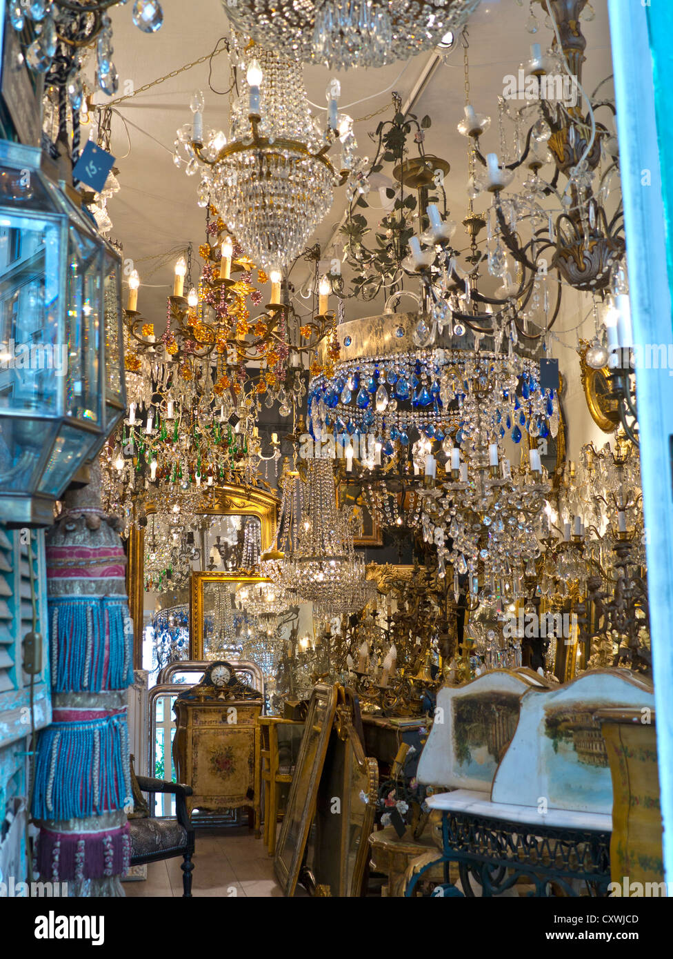 Antique bric a brac shop with variety of old crystal chandeliers on antique bric a brac shop with variety of old crystal chandeliers on display for sale aloadofball Choice Image