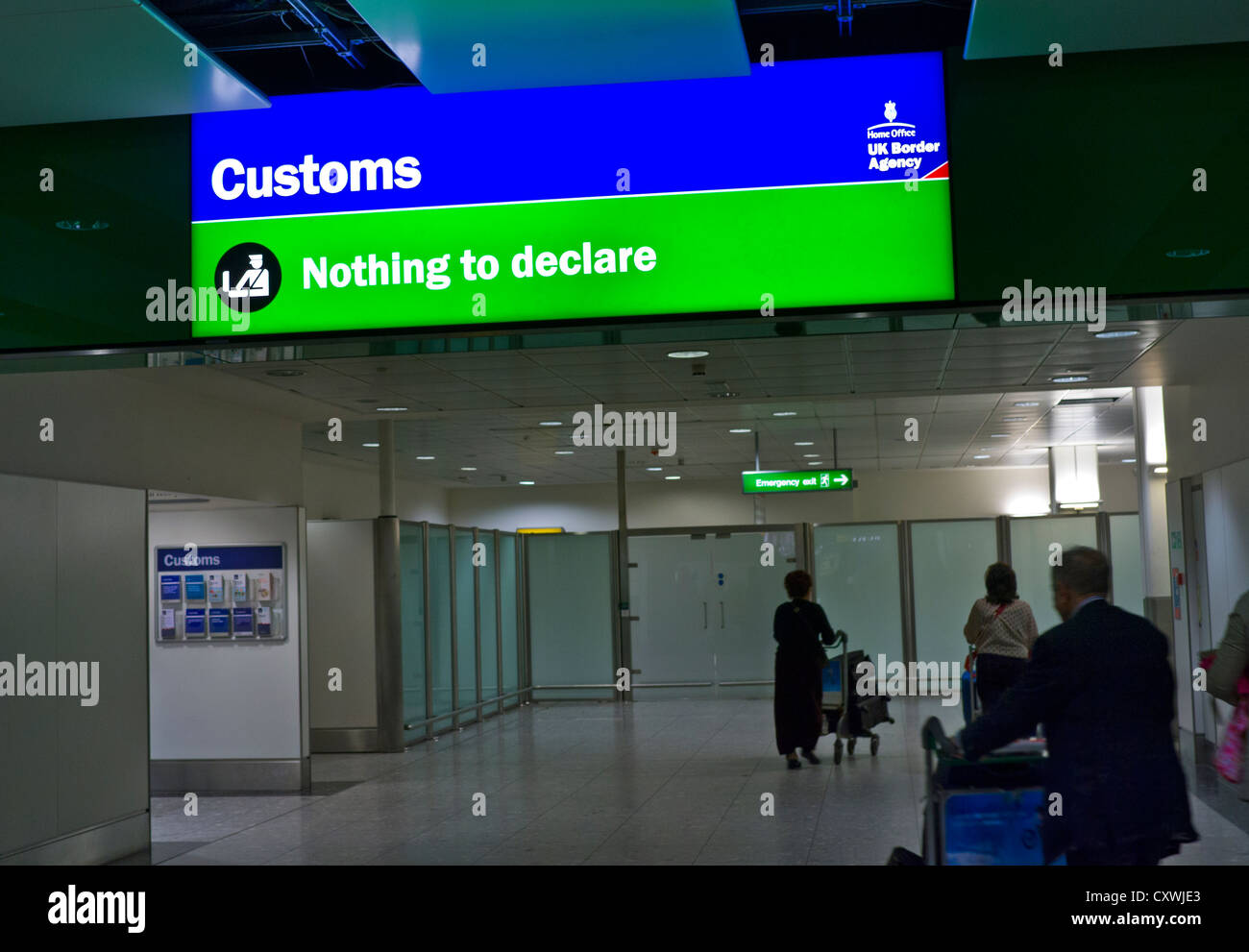 Green Channel 'nothing to declare' Customs passenger scrutiny point at London Heathrow UK - Stock Image