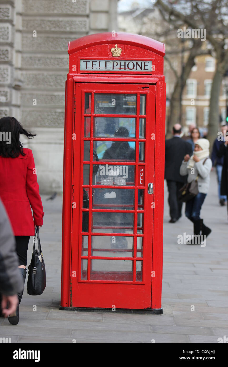 London, U.K. city, europe, phone box in busy street, photoarkive - Stock Image