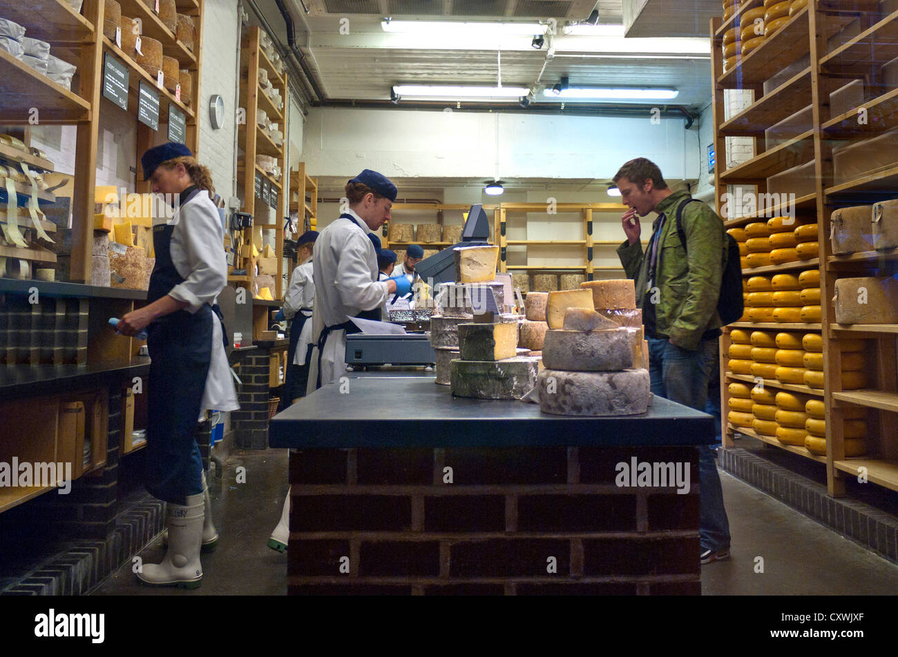 Neals Yard Dairy cheese shop interior at Borough Market London Bridge Southwark  London UK - Stock Image