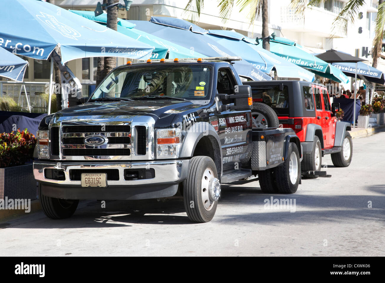 car being towed away for parking violation miami south beach florida usa - Stock Image