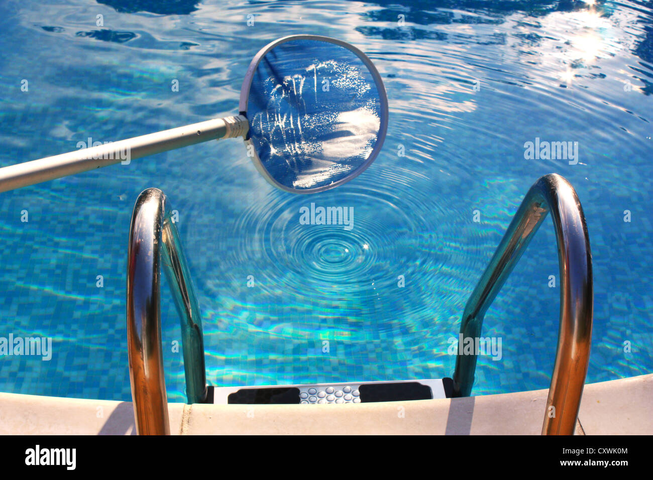 Cleaning net in swimming pool Stock Photo