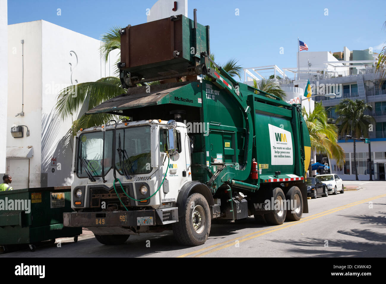 refuse truck collecting rubbish bins in miami south beach florida usa - Stock Image
