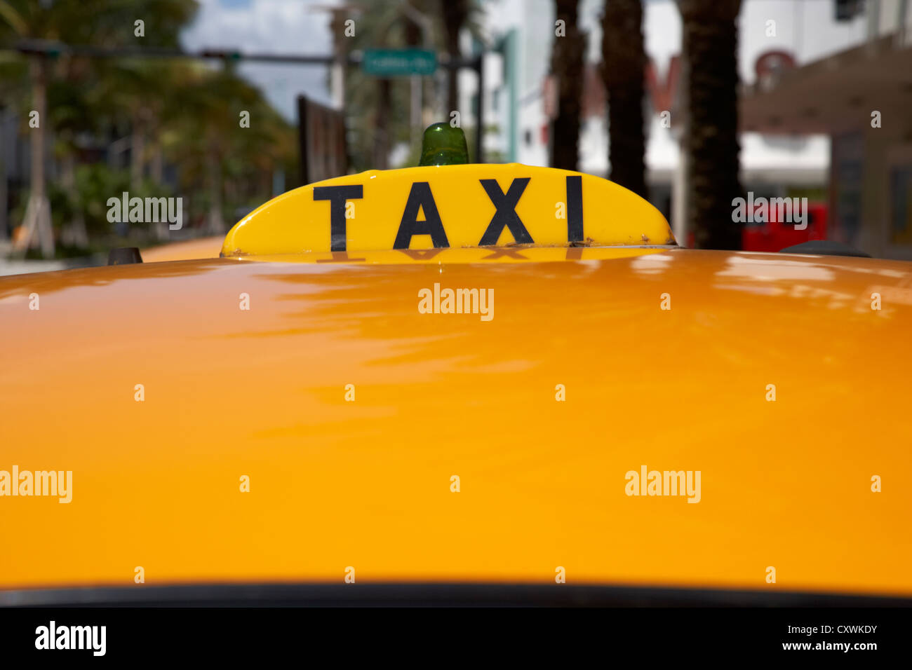 rooftop taxi sign on roof of cab in miami south beach florida usa - Stock Image