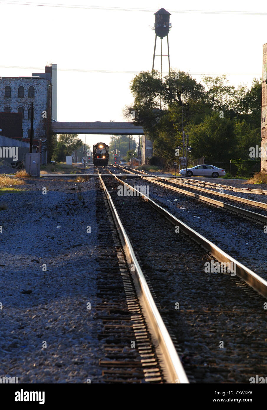 Train tracks in an industrial area - Stock Image