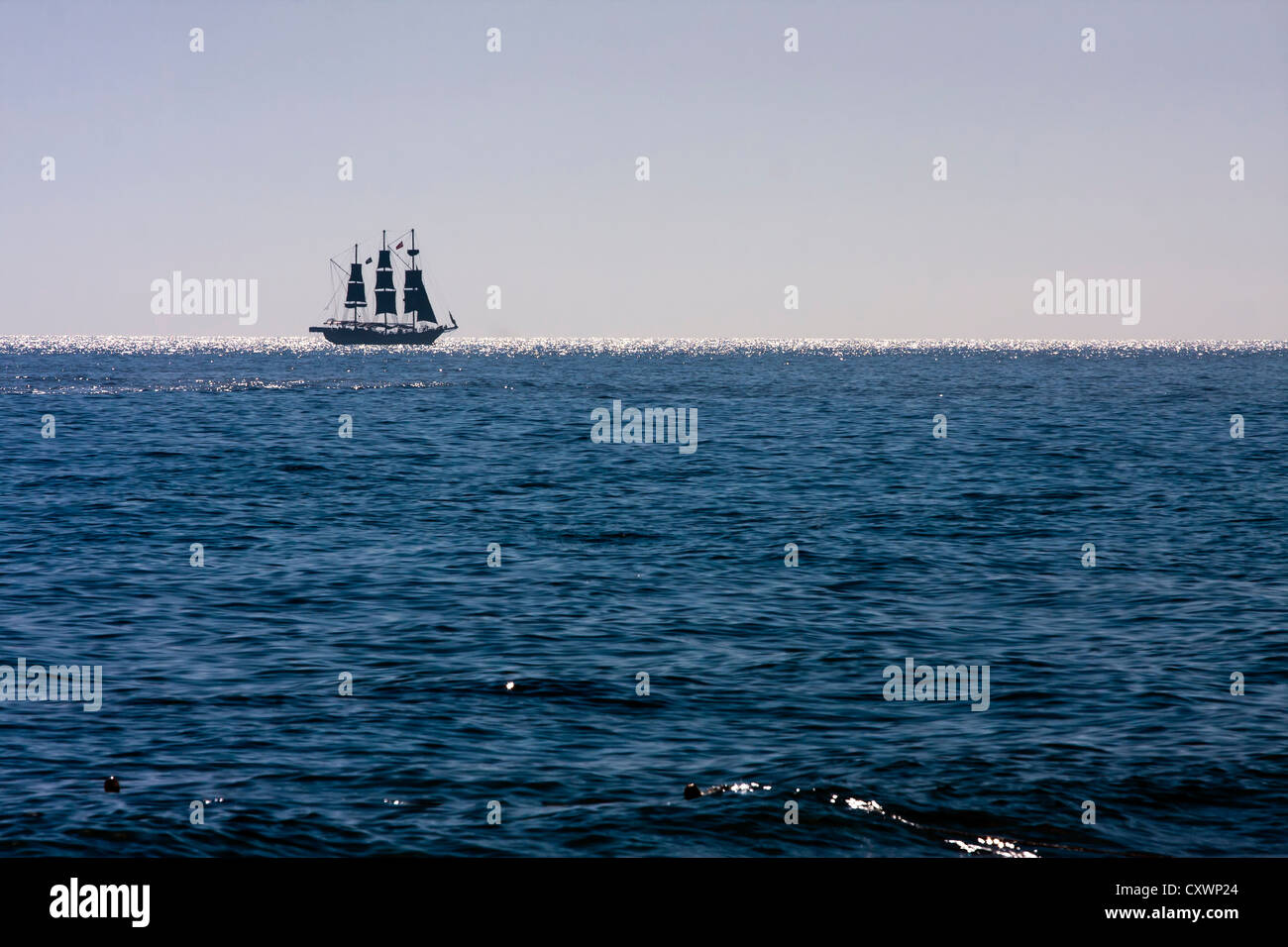 Sailing ship on the ocean. - Stock Image