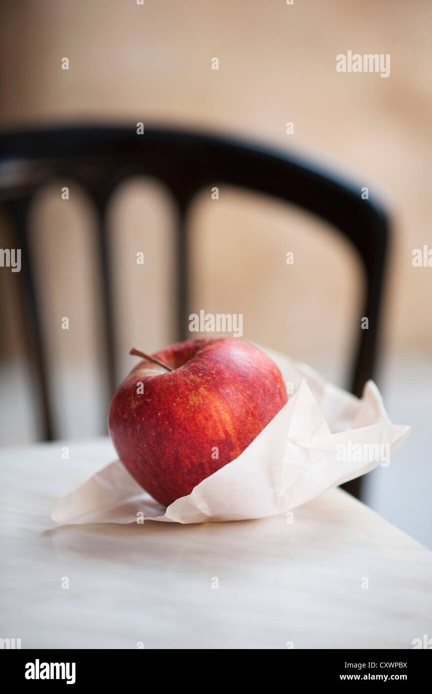 Close up of apple in paper bag - Stock Image