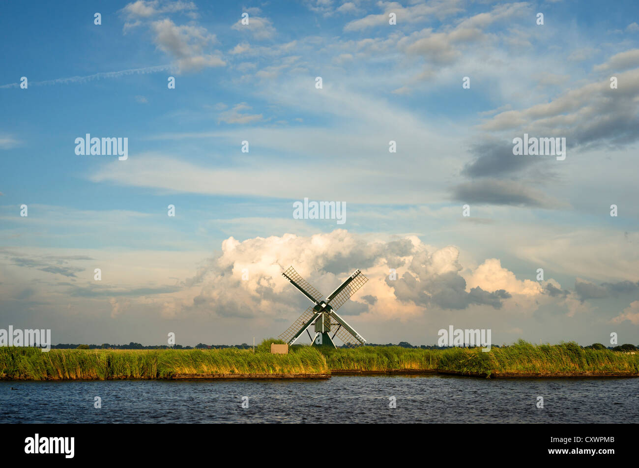 Windmill in rural landscape - Stock Image