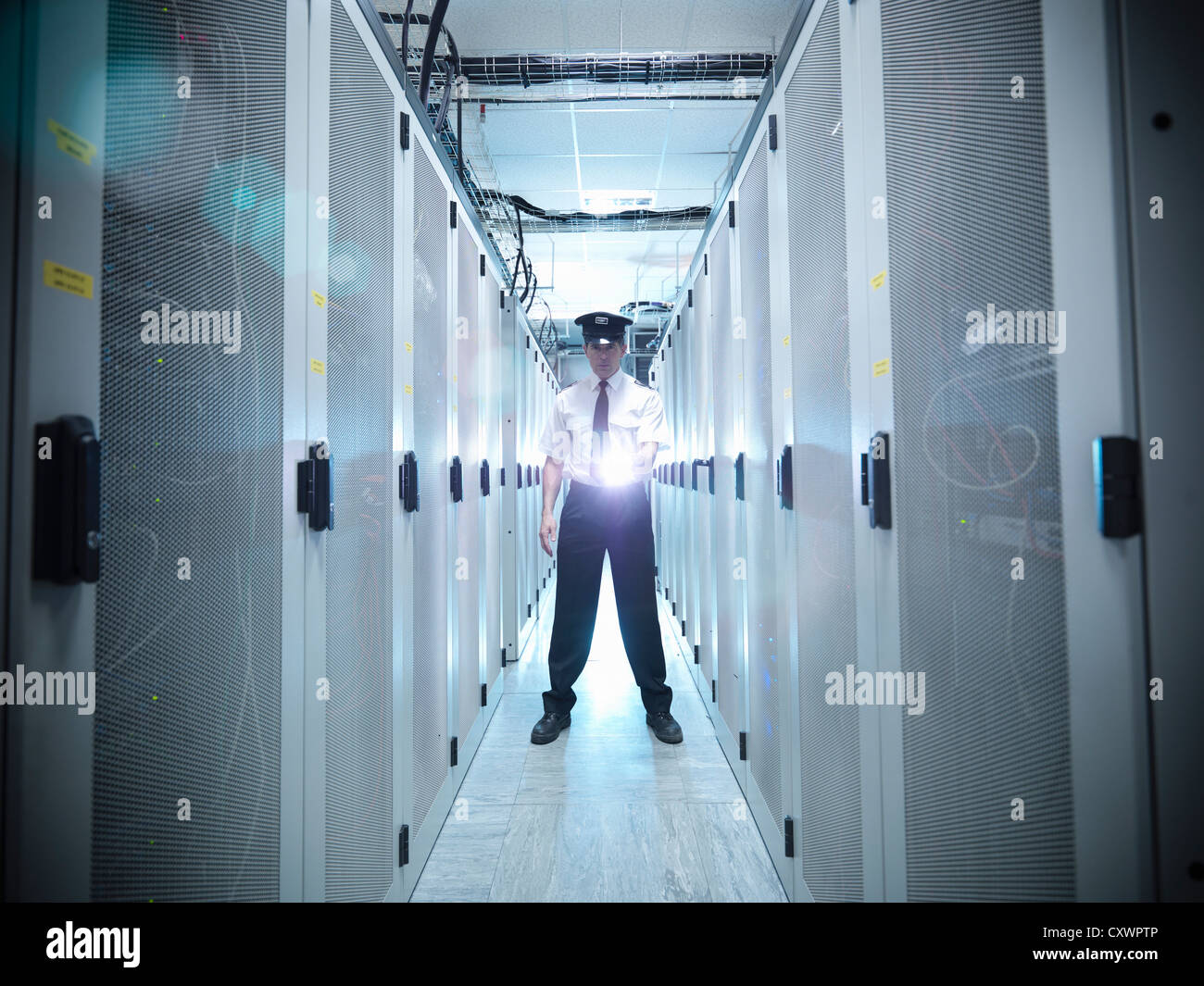 Security guard in server room Stock Photo