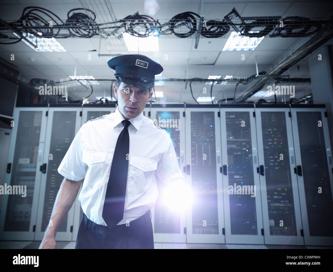 Security guard standing in server room Stock Photo