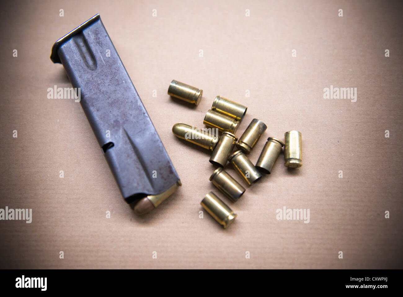 Close up of bullet casings and clip - Stock Image