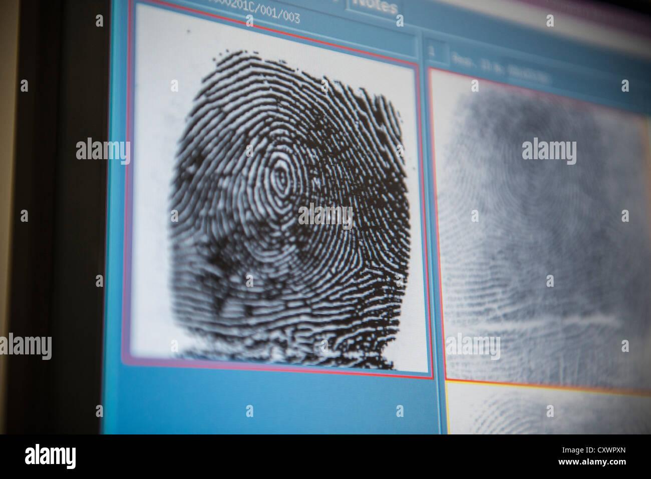 Fingerprints on screen in forensic lab - Stock Image