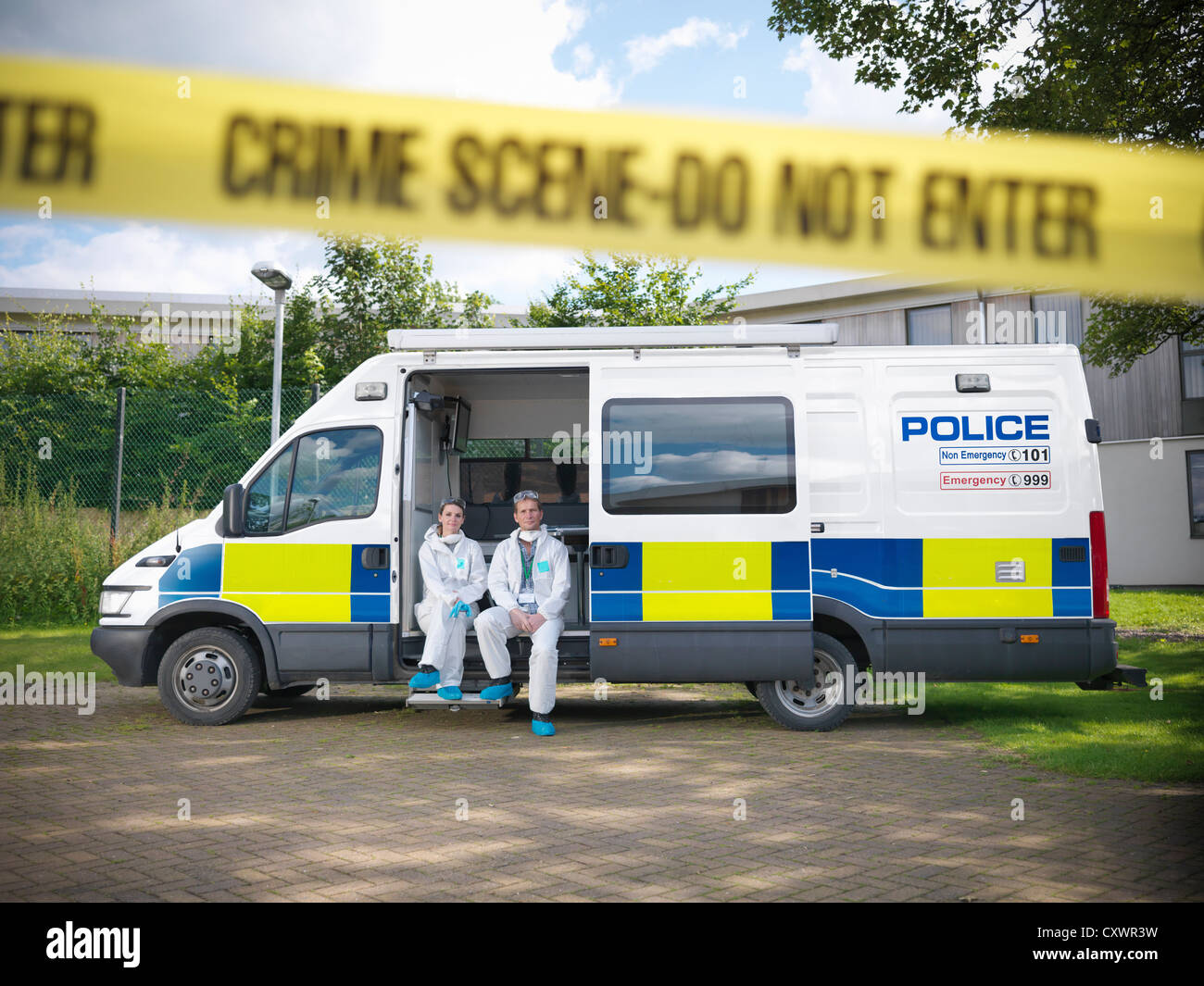 Forensic scientists at crime scene - Stock Image
