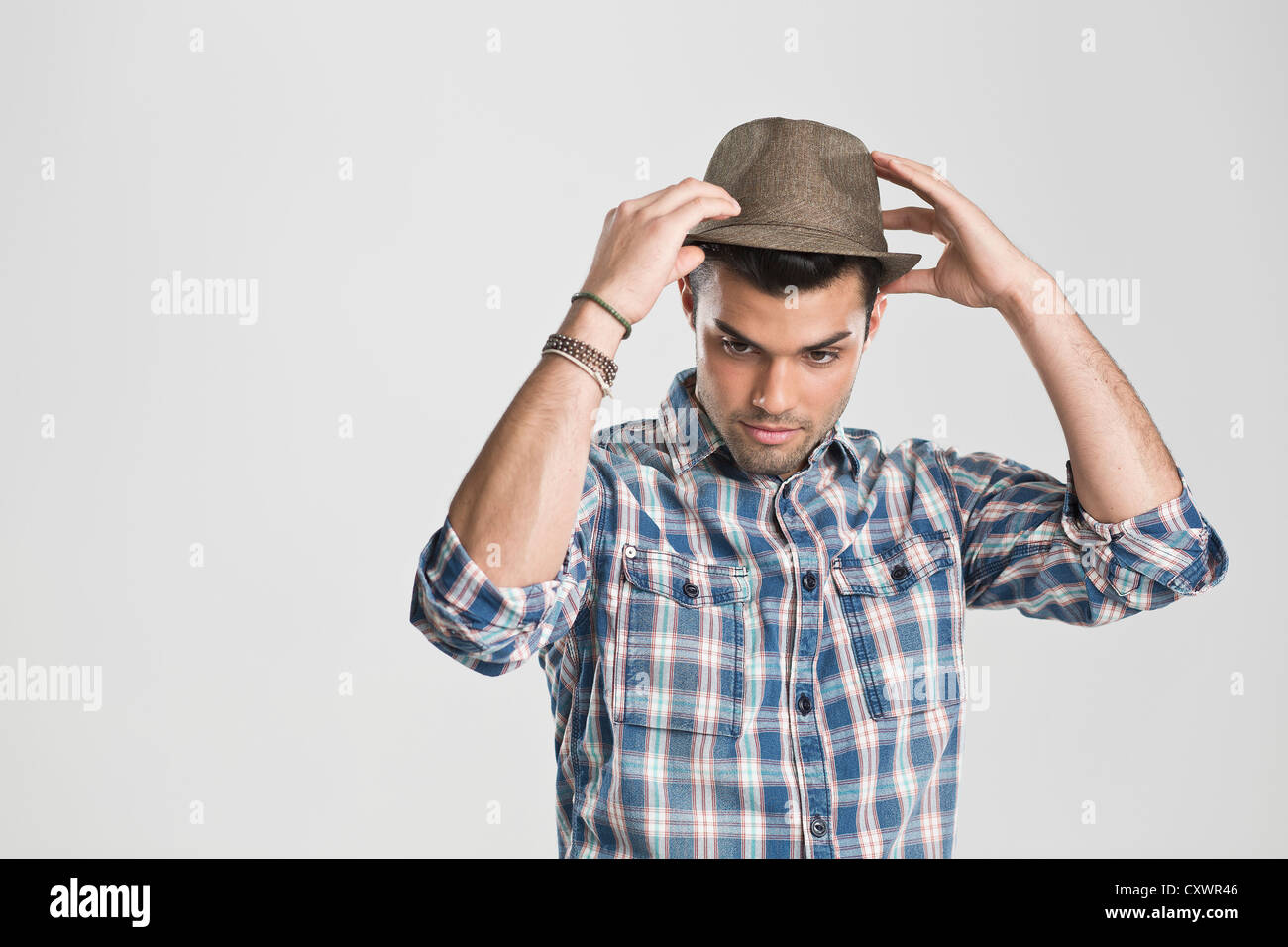 Man trying on hat - Stock Image