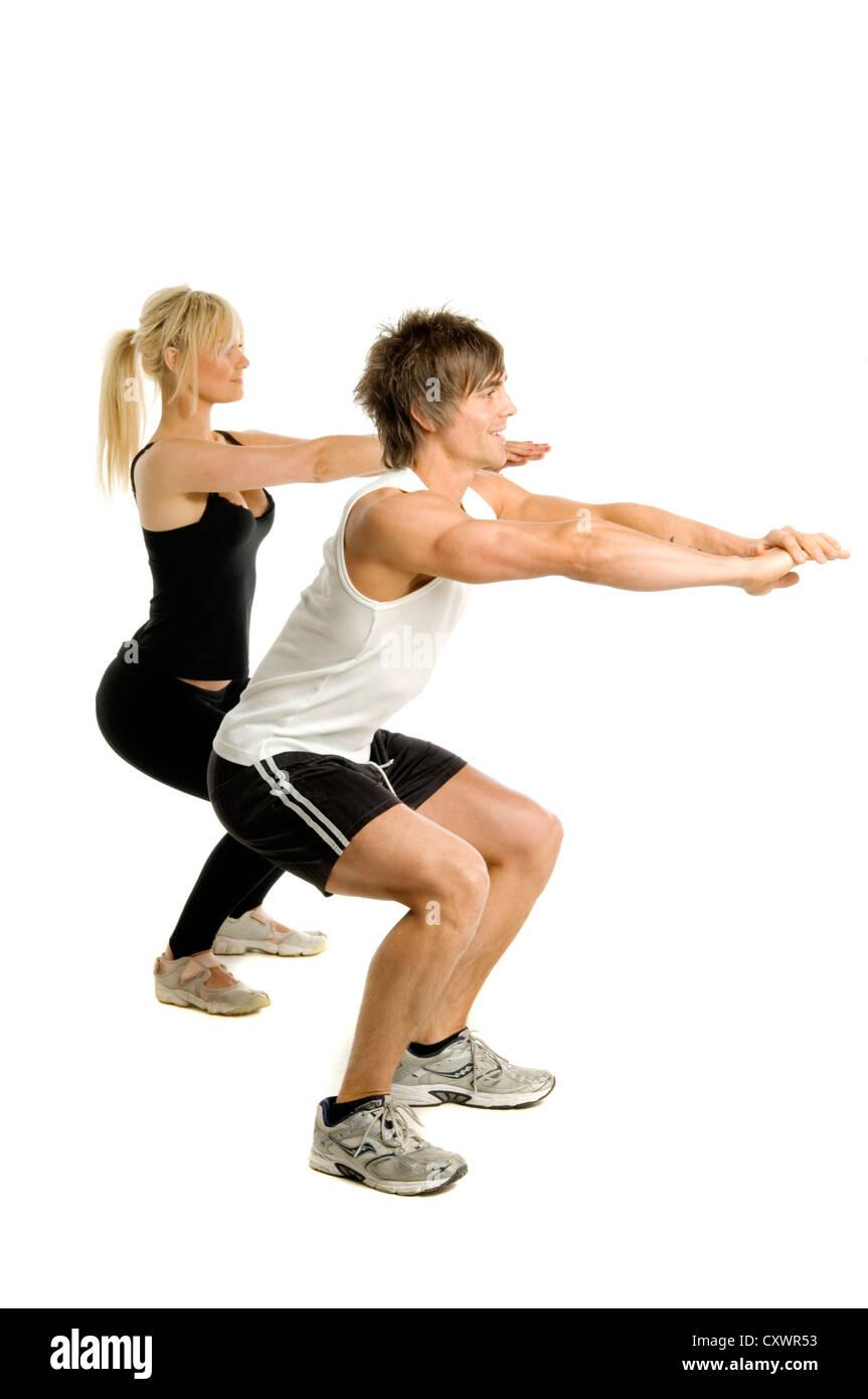 f35755cbbb Athletic man and woman doing cardio exercises isolated on a white  bakcground - Stock Image