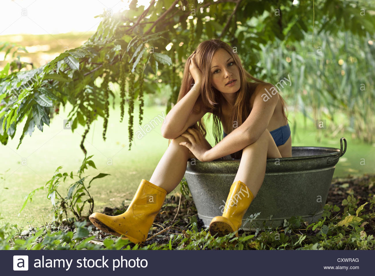 woman sitting in bucket in garden stock photo 50968920 alamy. Black Bedroom Furniture Sets. Home Design Ideas