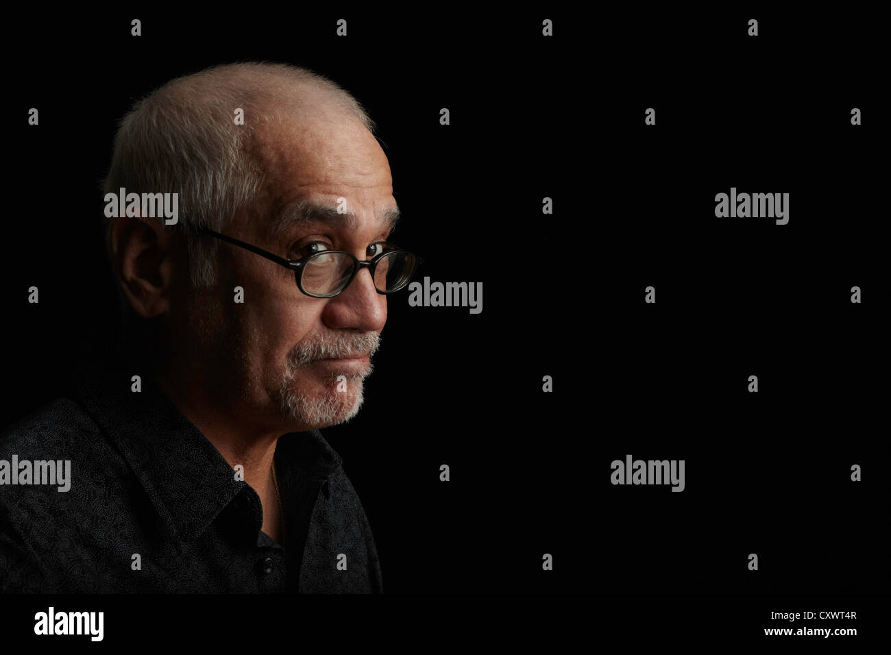 Smiling older man wearing eyeglasses Stock Photo