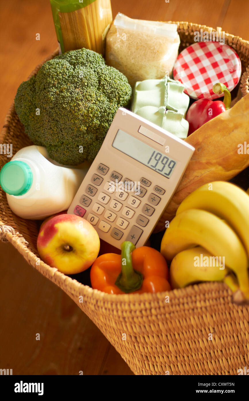 basket of groceries with calculator stock photo 50969569 alamy