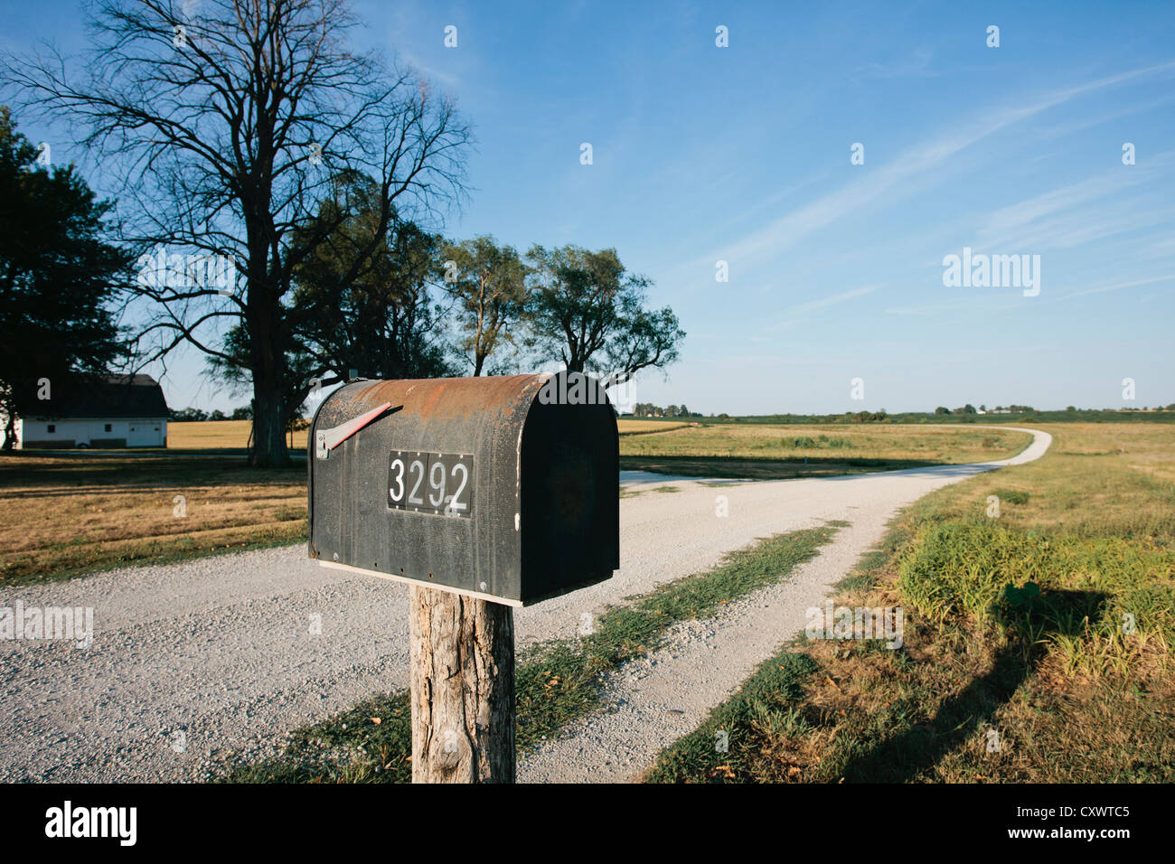 Close up of mailbox on rural dirt road - Stock Image