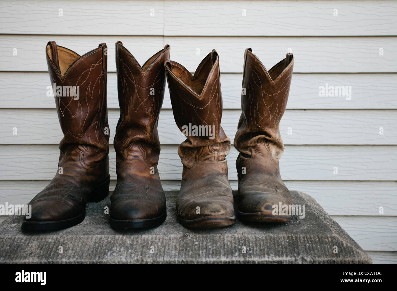 Close up of worn cowboy boots - Stock Image