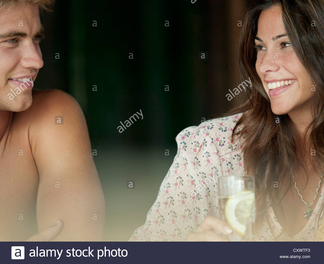 Couple laughing at each other - Stock Image