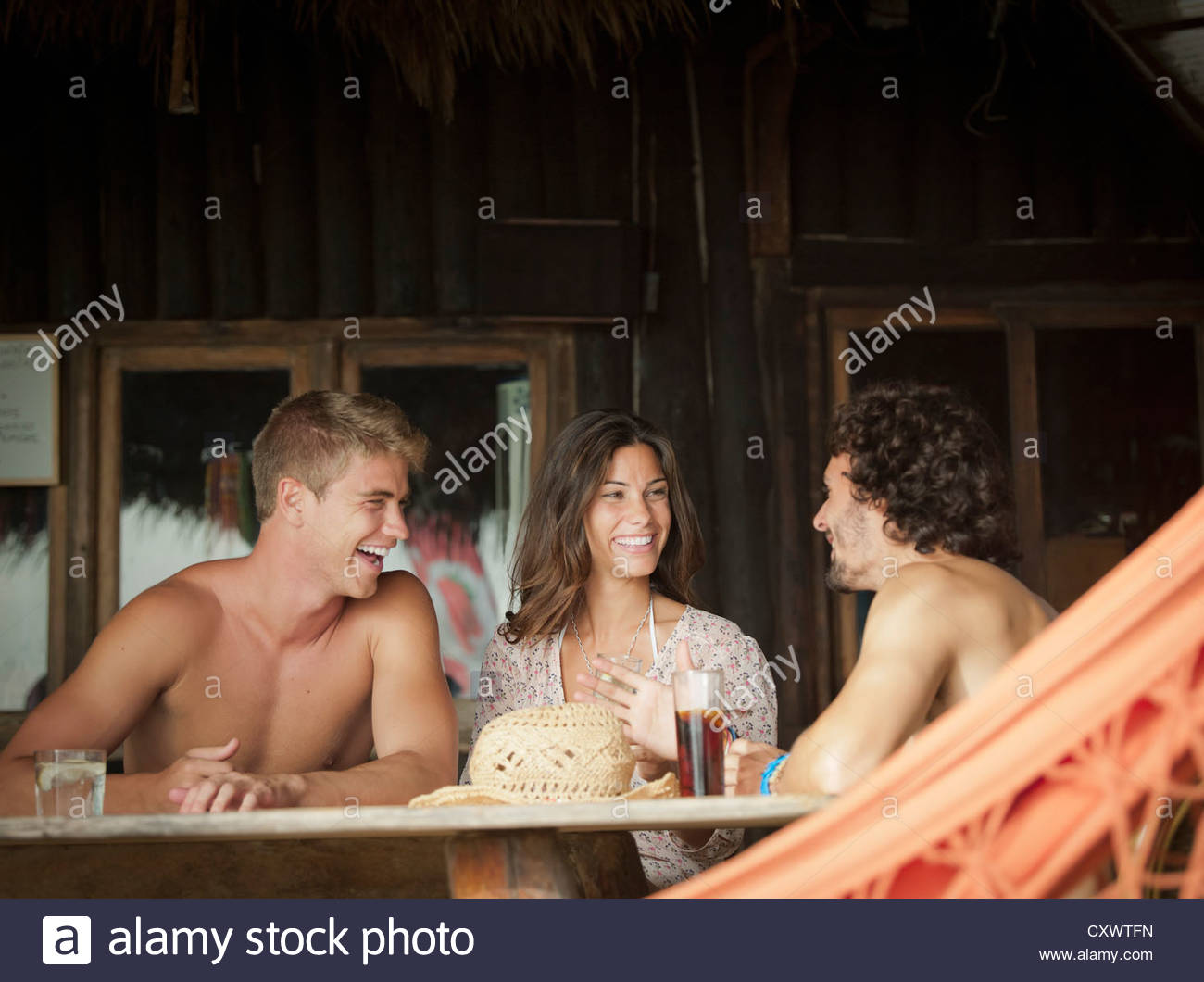 Friends having drinks together - Stock Image