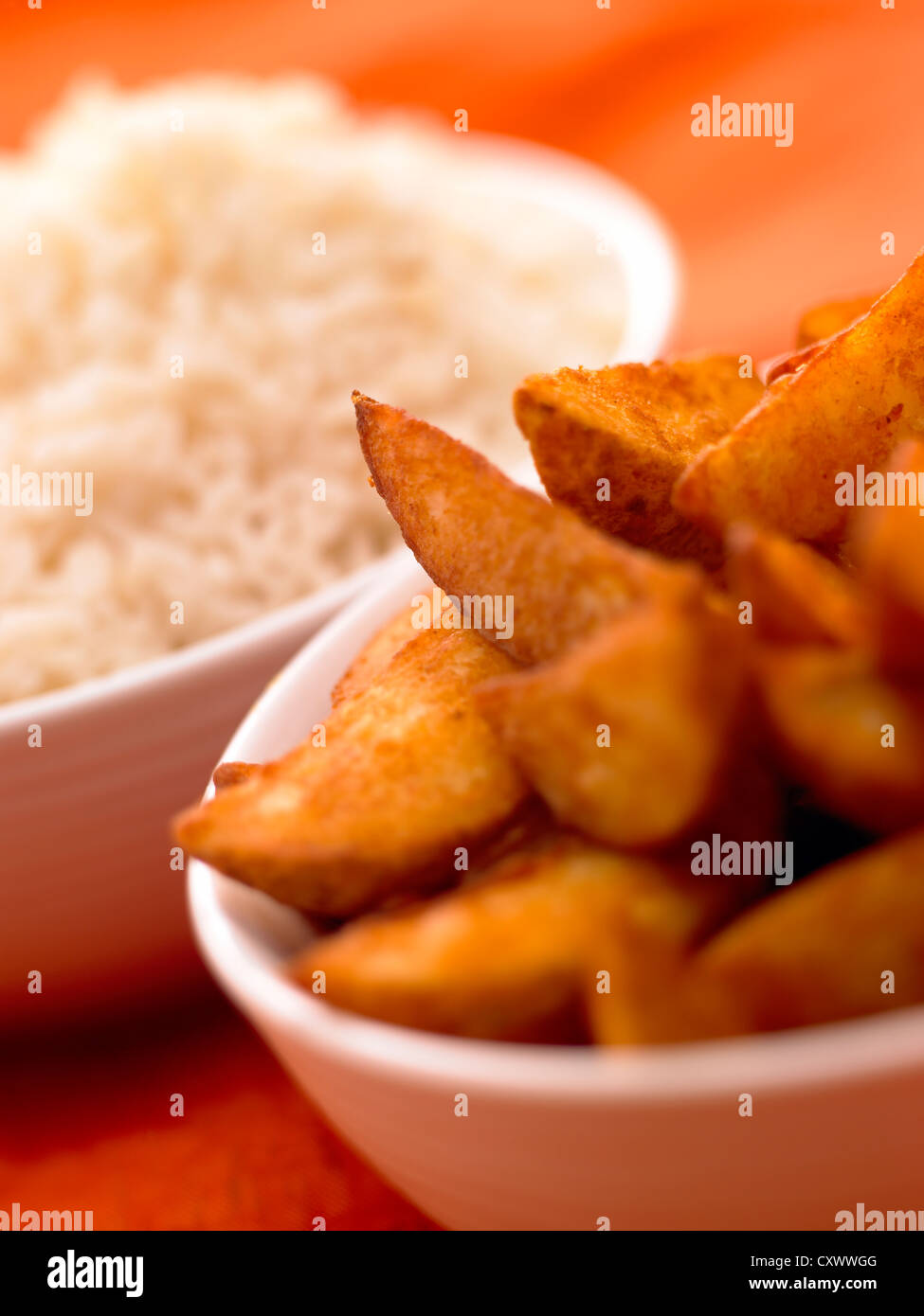 potato wedges and rice close up - Stock Image
