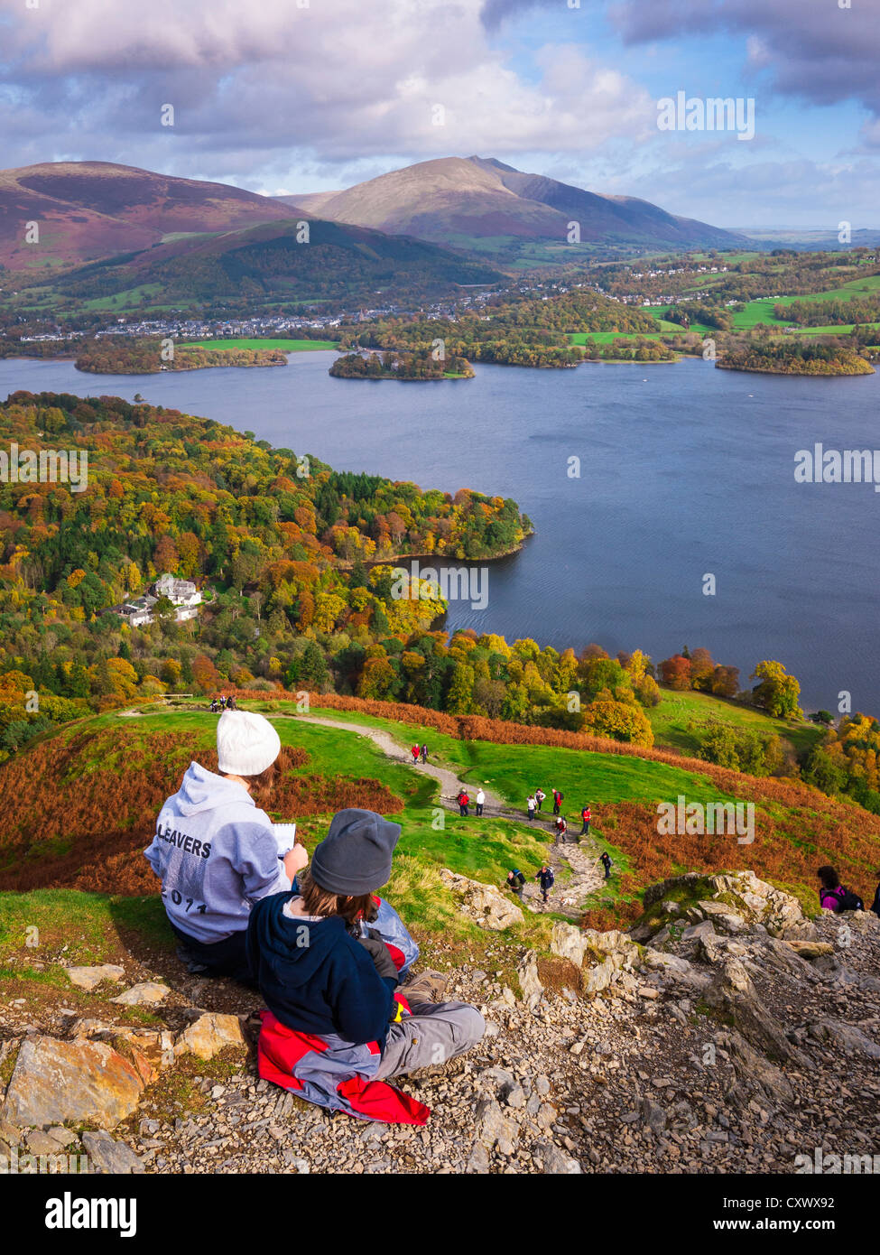 Teenage brother and sister enjoying the view over Derwent Water from Catbells in the Lake District. Keswick Cumbria - Stock Image
