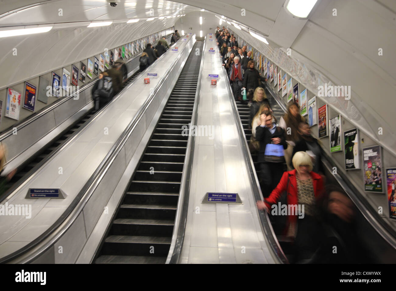 London, England, U.K., tube staircase, stairway, people going down on underground staircase, escalators - Stock Image