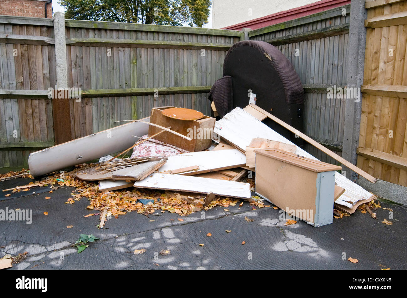 fly tipping flytipping rubbish dump dumping illegal unauthorized - Stock Image
