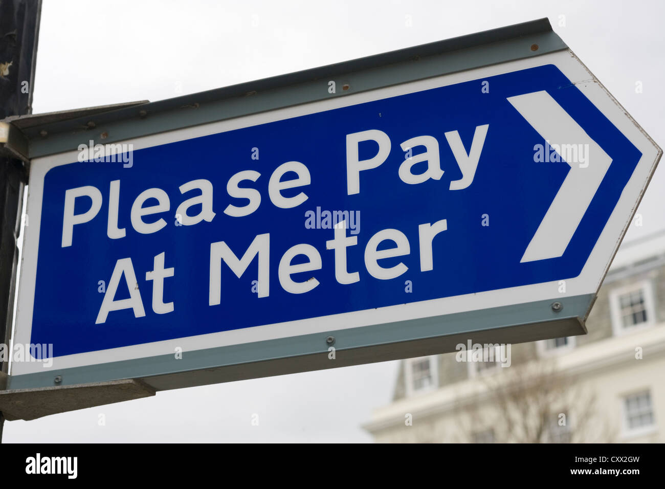 Please Pay At Meter sign in a car park, Pay here, UK - Stock Image