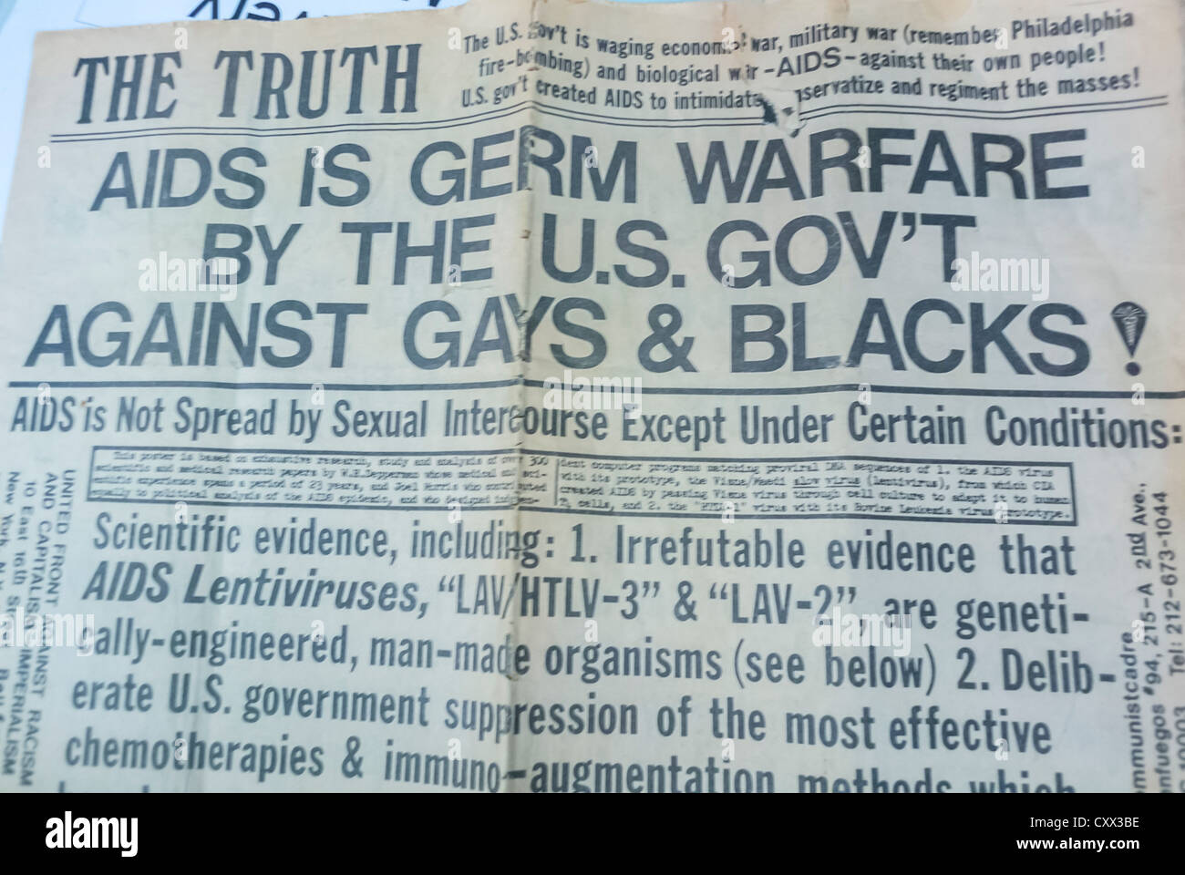 """New York, NY, USA, Communist Party Newspaper Headlines claiming """"AIDS is Germ Warfare by the U.S. Government Against Stock Photo"""