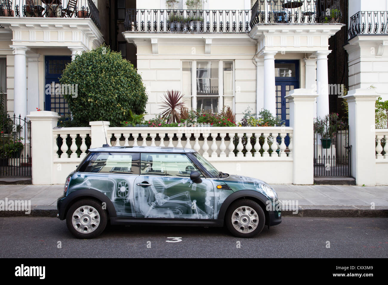 Mini car in front of London residence. - Stock Image