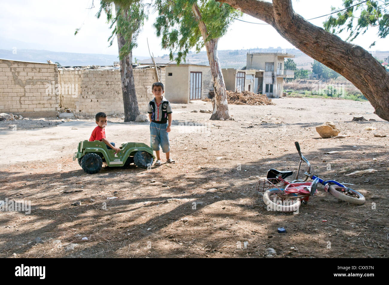 Two Syrian refugee children sheltering the across the border in the northern Lebanese region of Wadi Khaled. - Stock Image