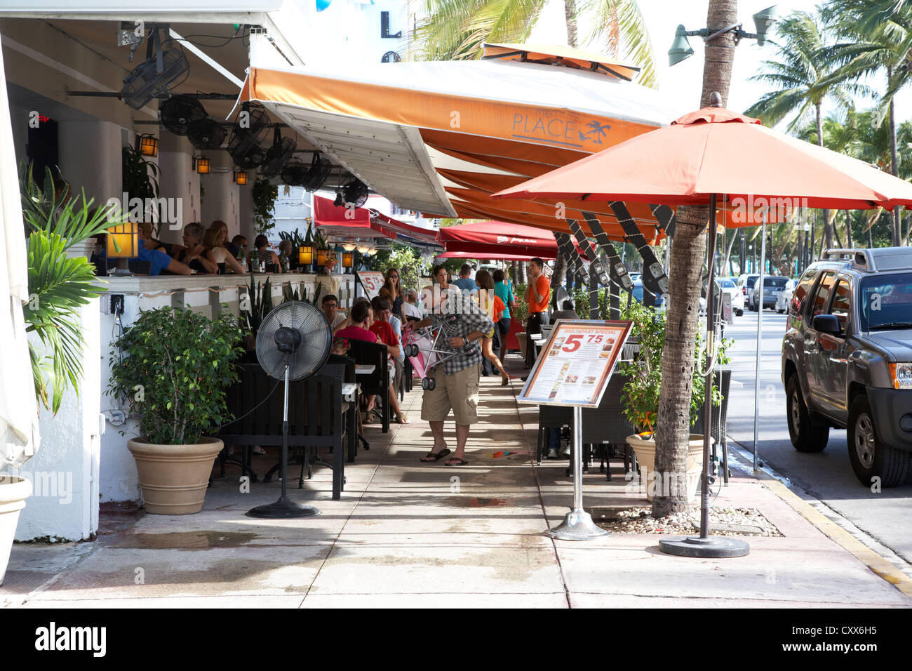 on street sidewalk cafe in the art deco historic district ocean drive miami south beach florida usa - Stock Image