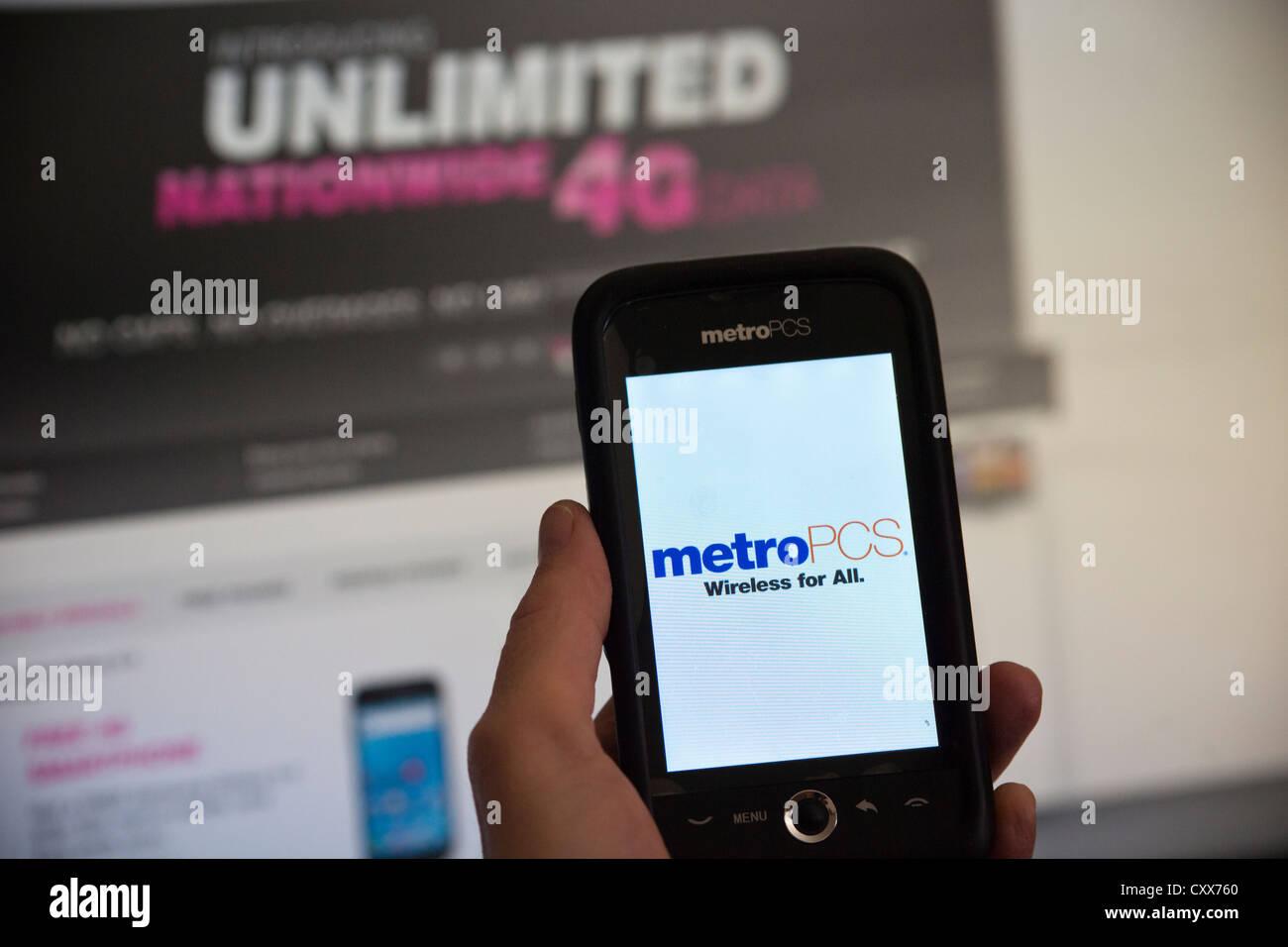 A consumer uses her MetroPCS phone while browsing the T-Mobile USA