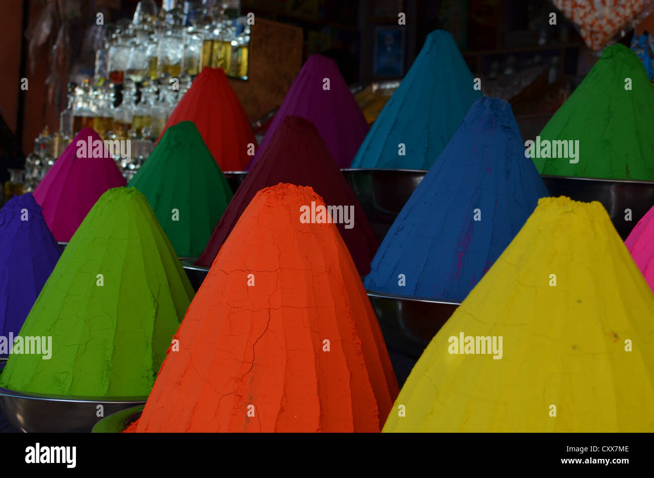 colourful cones of paint for sale in an Indian market - Stock Image