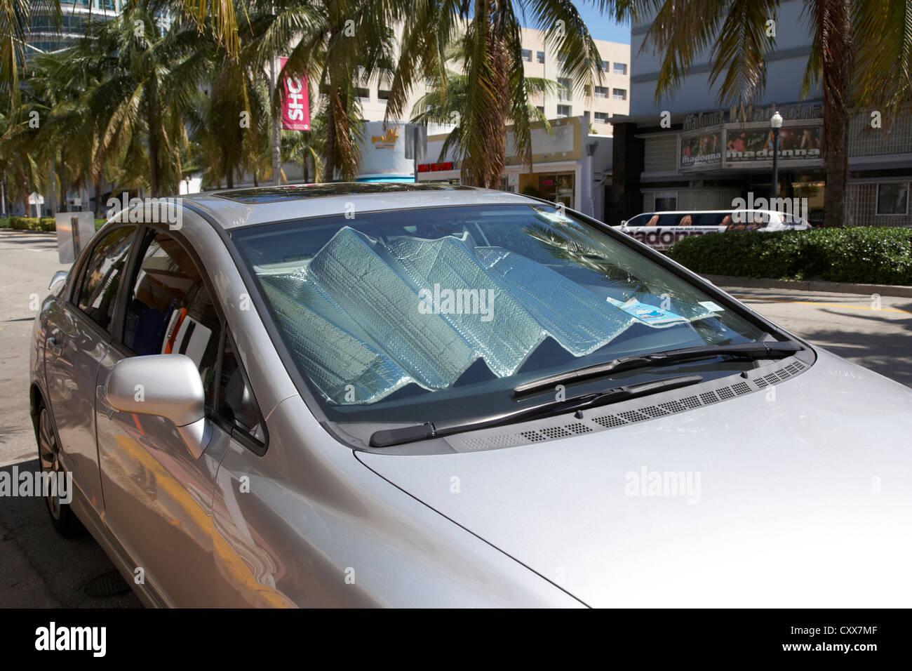 car with windshield sun reflector miami south beach florida usa - Stock Image