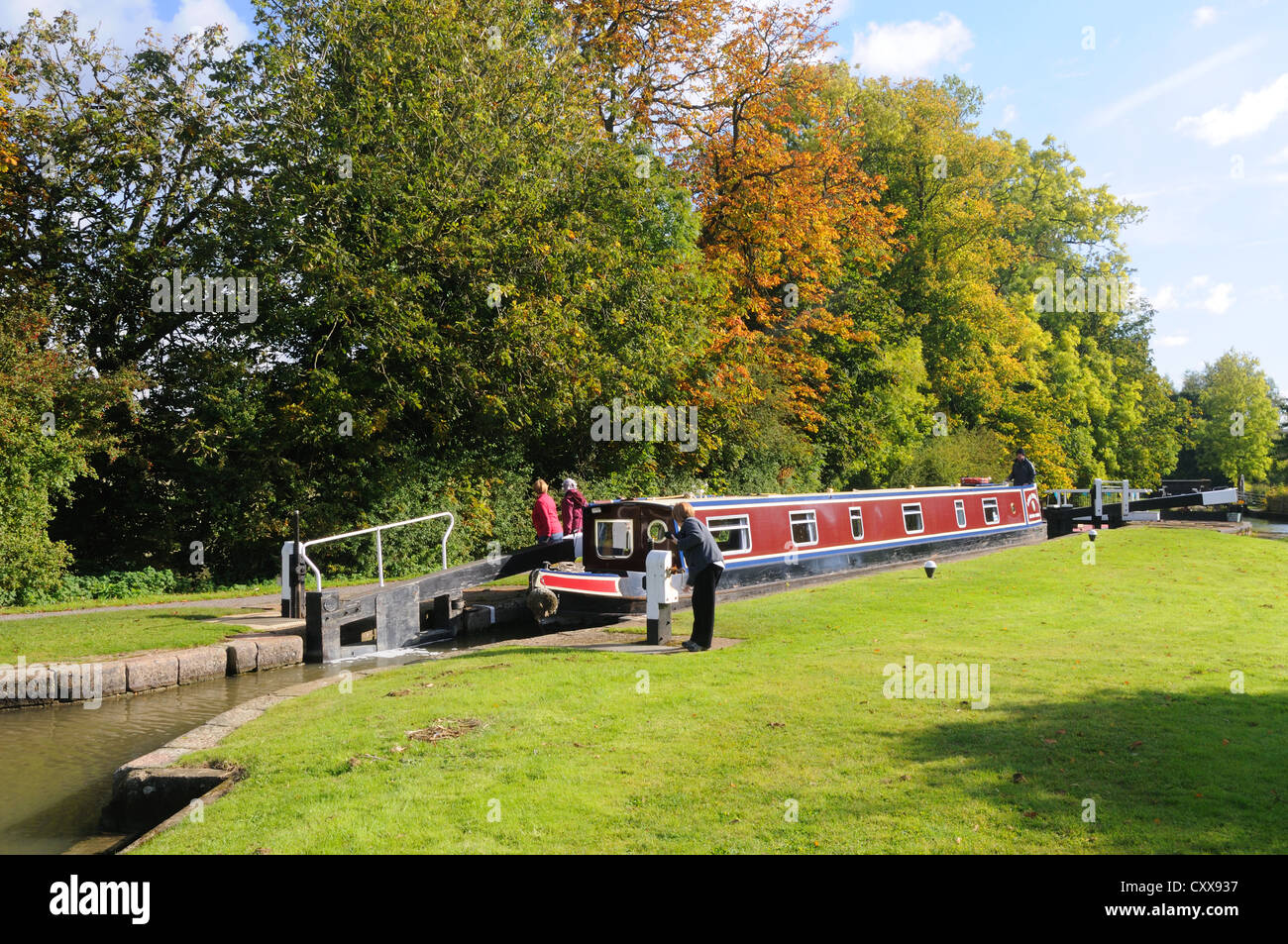 66' narrowboat 'Lord Portal' in Lock No. 2 of the Watford flight on the Grand Union Canal at Watford, - Stock Image