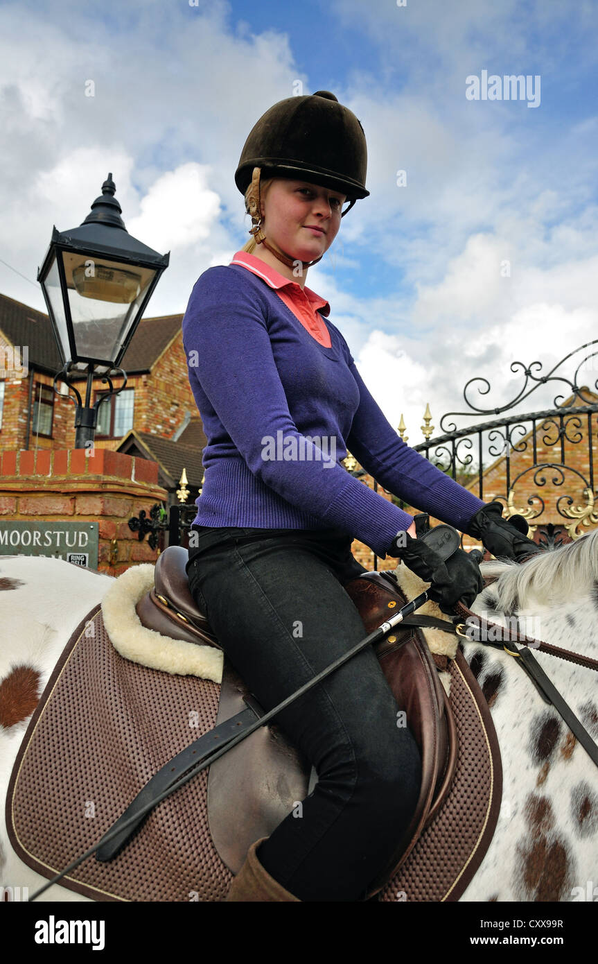 Teenage girl riding Appaloosa horse, Stanwell Moor, Surrey, Berkshire, United Kingdom - Stock Image
