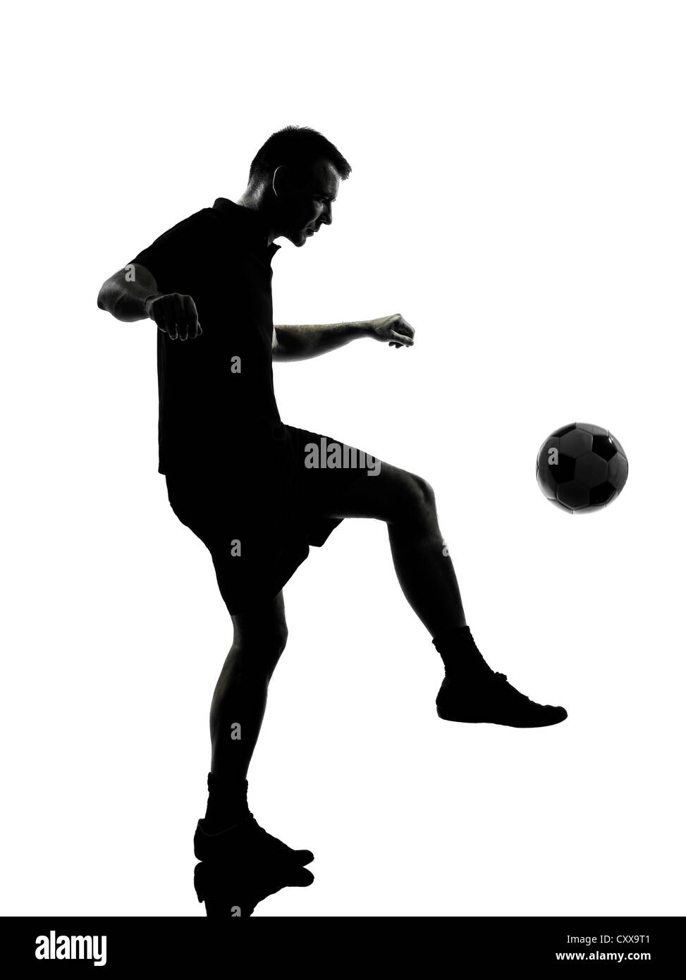 one man soccer player in studio silhouette isolated on white background - Stock Image