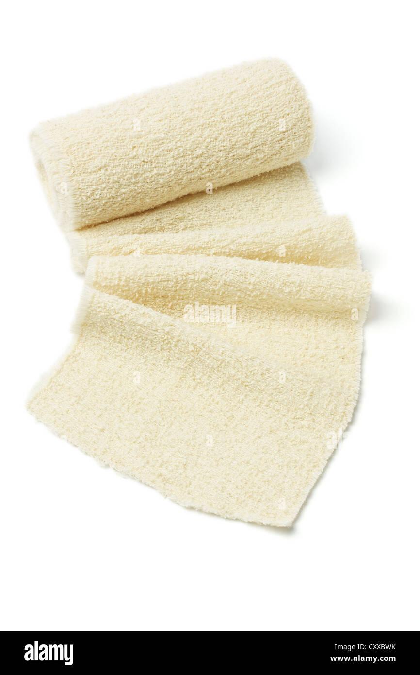Roll of Elastic Crepe Bandage on White Background - Stock Image