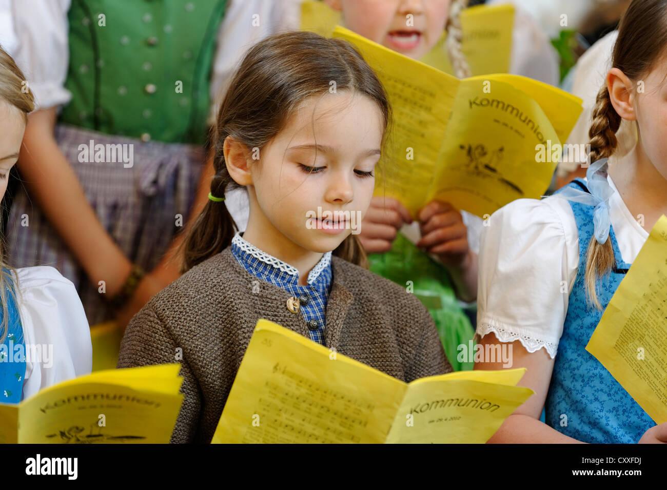 Girl singing in a children's choir, Bavaria - Stock Image