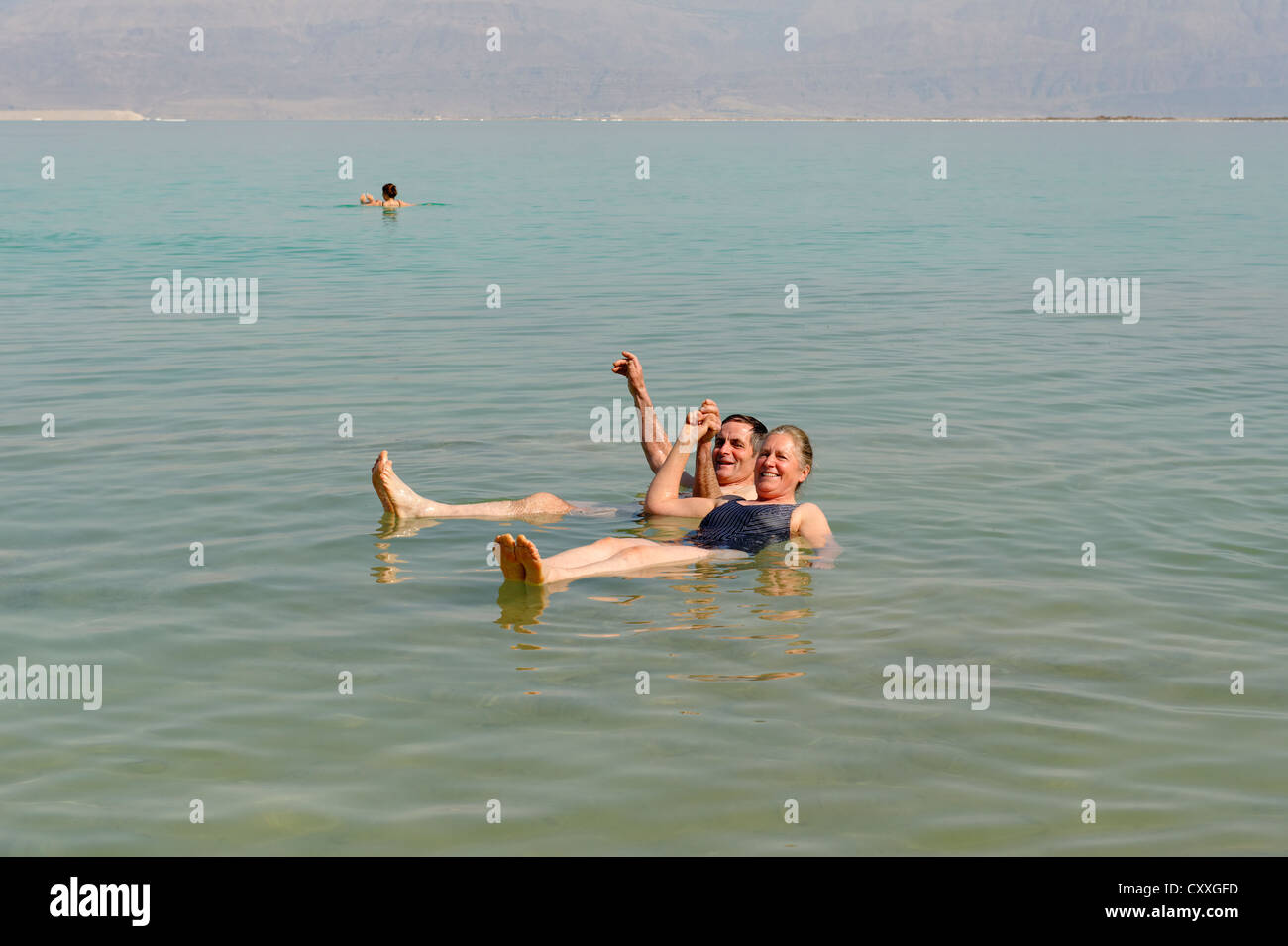 Bathing, swimming tourists in Ein Bokek, En Boqeq, Dead Sea, Israel, Middle East - Stock Image