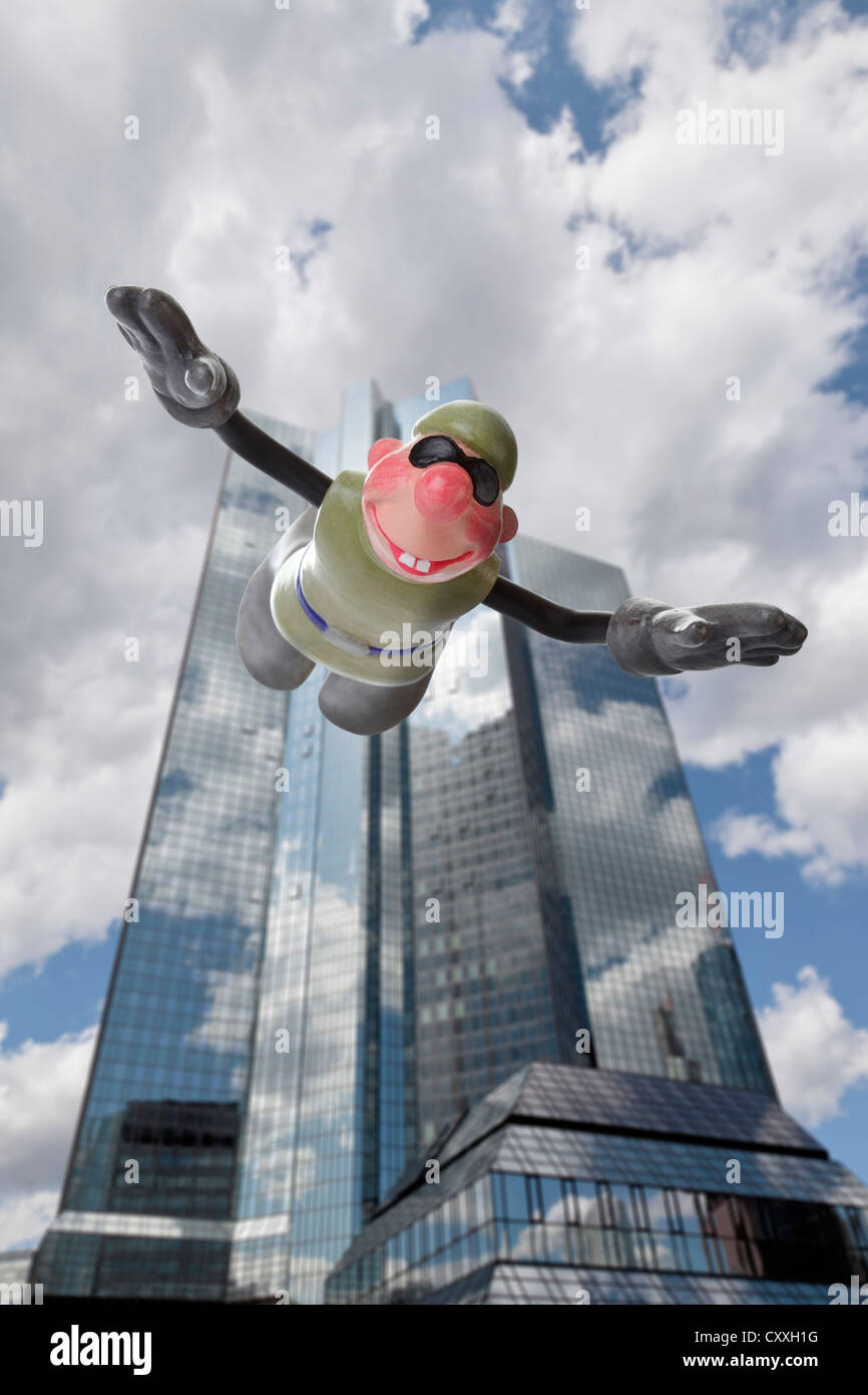 Cartoon character, basejumper in front of a Frankfurt banking house, free fall - Stock Image