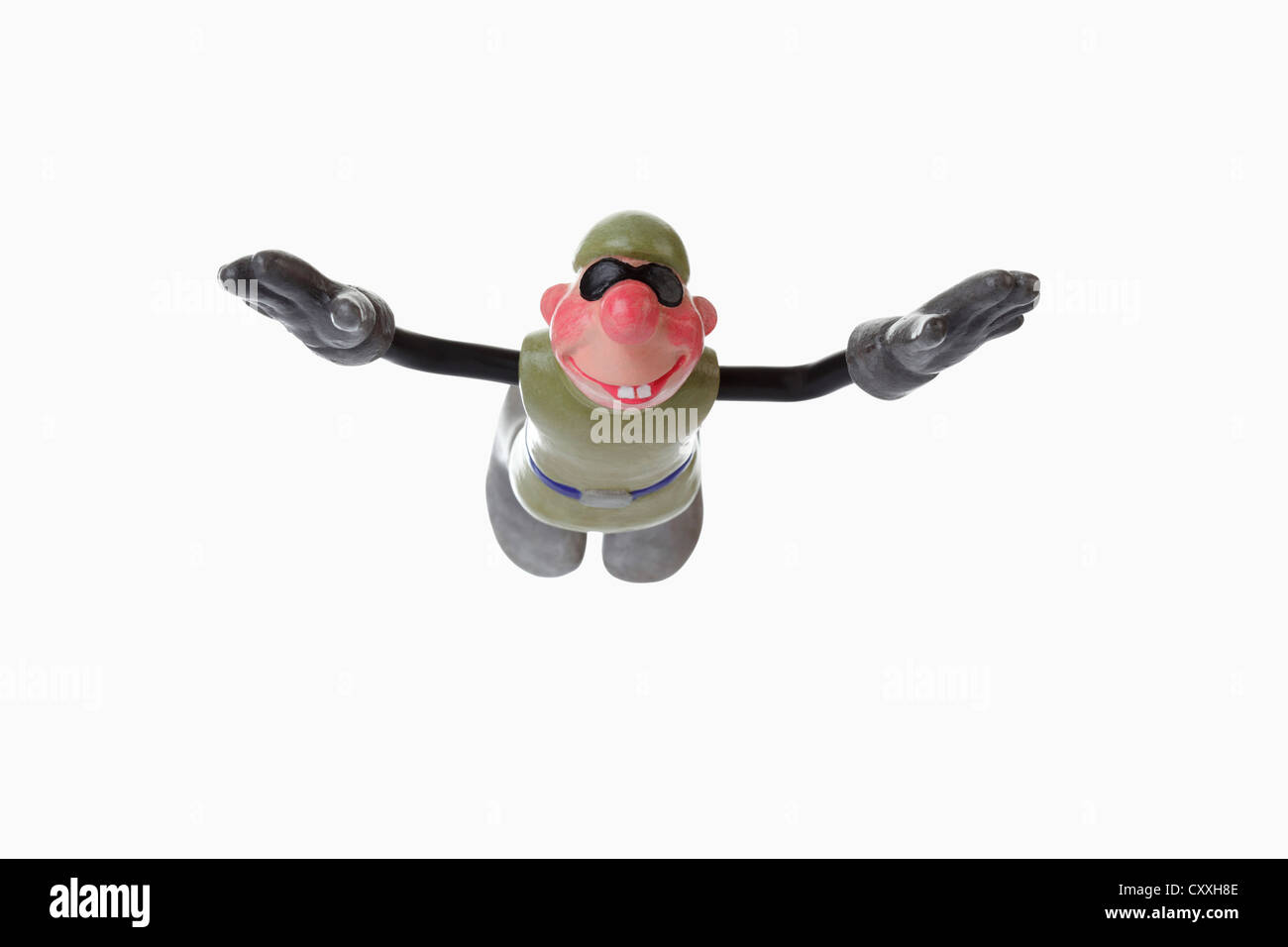 Comic figure, basejumper in free fall - Stock Image